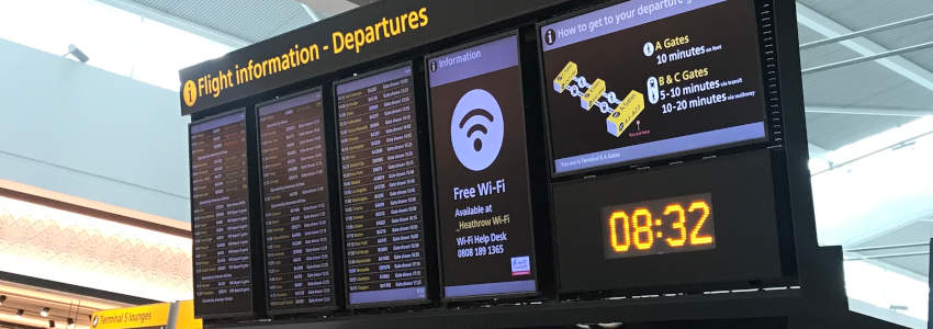 Departure board at airport showing missed flight connection